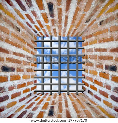 Prison's window and bars in wall from red brick with beams of sun - stock photo