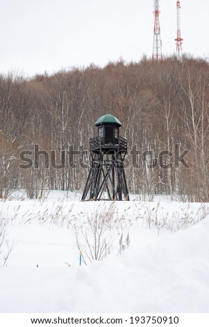 Prison Watch Tower in the Winter - stock photo