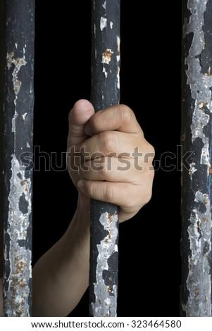 Prisoner hand holding iron bar. add vignette - stock photo