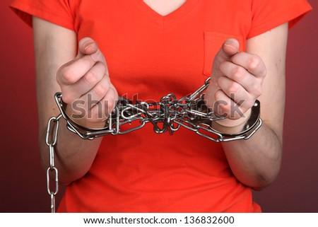 Prisoner in handcuffs - stock photo