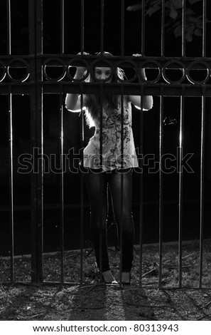 Prisoner in the night - dramatic lighting - stock photo
