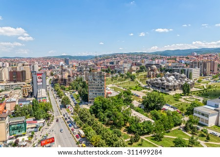 PRISTINA, KOSOVO - JULY 01, 2015: Aerial view of capital city with some old buildings like National Public Library and Christ the Saviour Cathedral. - stock photo