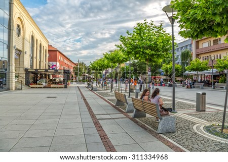 PRISTINA, KOSOVO - JULY 04, 2015: People walking on newly renovated Mother Teresa street in the city center. - stock photo