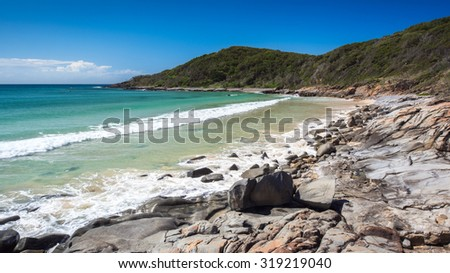Pristine Beach Paradise on a Summers Day With a Rocky Shoreline And Overlooking The Noosa National Park, Granite Bay, Noosa Heads, Sunshine Coast, Queensland, Australia - stock photo