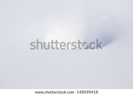 pristine snow with circular depression - stock photo
