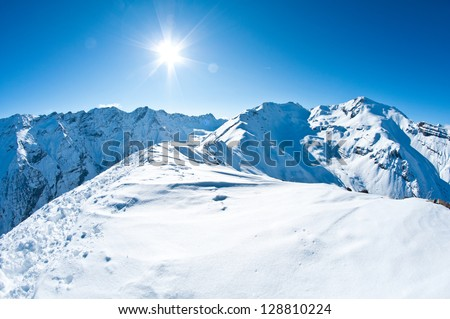 pristine winter mountaintop scenery - stock photo