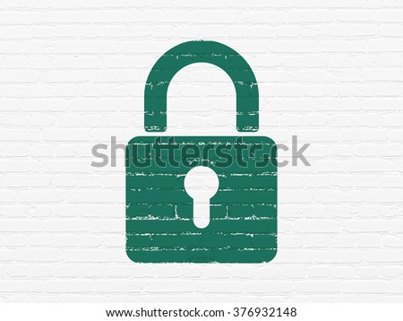 Privacy concept: Closed Padlock on wall background