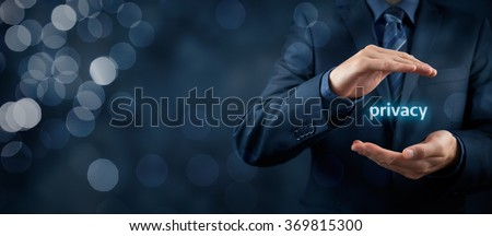Privacy policy concept. Businessman with protective gesture and text privacy in hands. Wide banner composition with bokeh in background. - stock photo