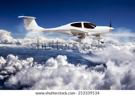 Private aircraft in the clouds. - stock photo