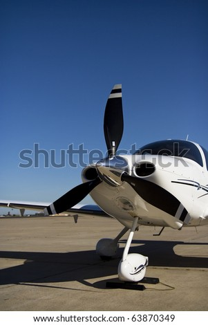 Private Airplane A private single engine propeller airplane. Vertical. - stock photo