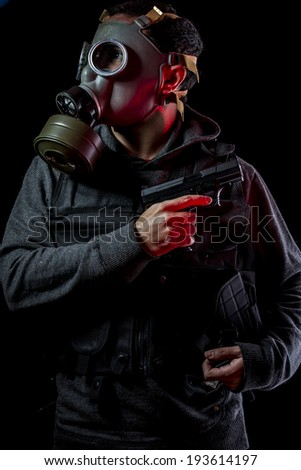 Private detective with bulletproof vest and gas mask, toxic