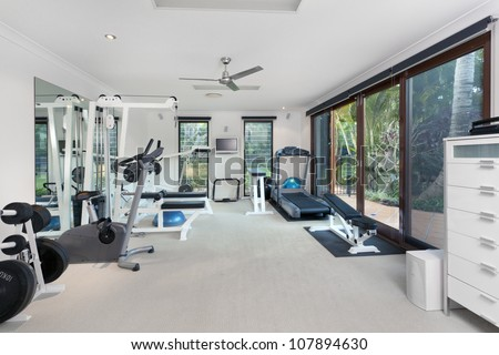 Private gym in luxury home - stock photo