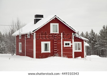 Private house of red color on a background winter nature. Finland