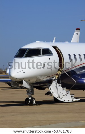 Private Jet A private jet airplane waiting for passengers. Vertical. - stock photo