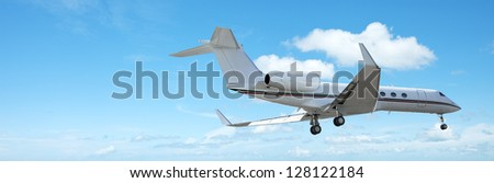 Private jet aircraft in flight. Panoramic composition. - stock photo