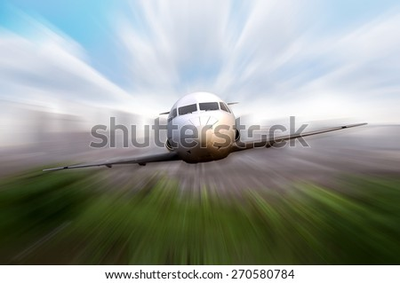 Private jet fly with motion blur effect background - stock photo