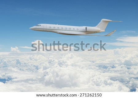 Private jet flying on the sky