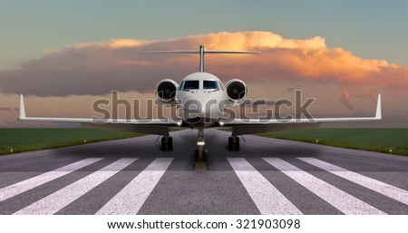 Private jet on the runway ready for take off - stock photo