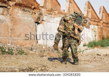 Private Military Contractor during the rescue operation - stock photo