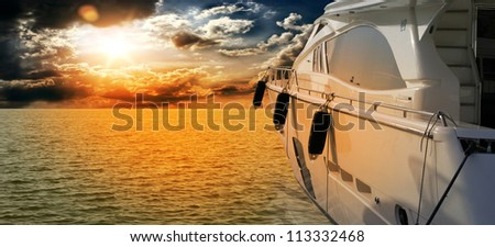 Private motor yacht to incredible sunset.Sailboat, motor boat - stock photo