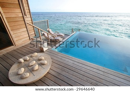 private pool and game board in luxurious villa
