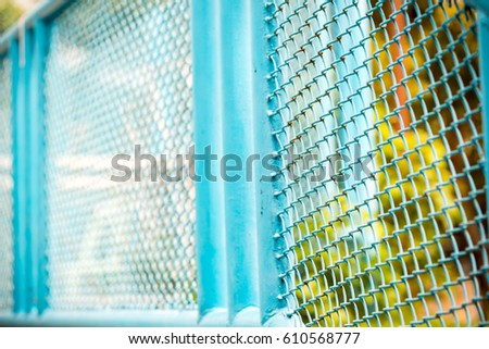 private property silver chain link fence pattern with tree on background blue chain