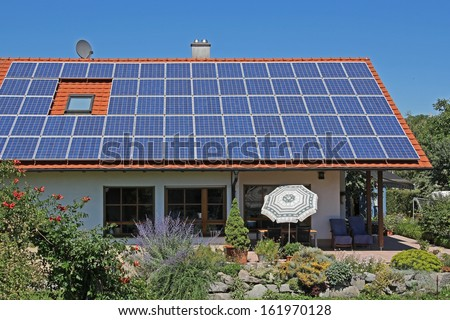 Private residential building with photovoltaic module - stock photo