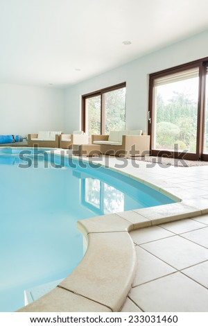 Private swimming pool in modern luxury apartment - stock photo
