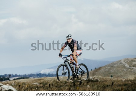 Privetnoye, Russia -  September 21, 2016: male cyclist mountainbiker on sports bike in mountains during Crimean race mountainbike