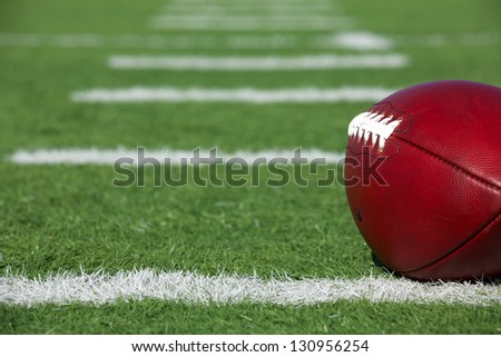 Pro American Football on the Field near the yard lines - stock photo