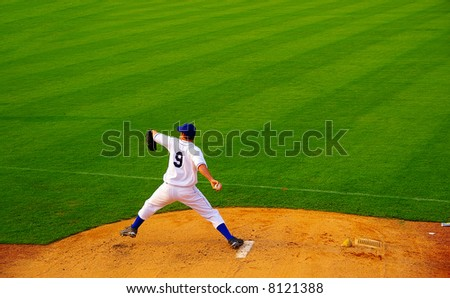 Pro baseball  pitcher throwing the ball from the mound - stock photo