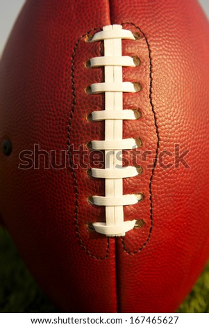 Pro Football Close Up with Focus on the Laces for Sports Background