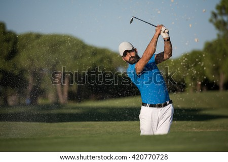 pro golf player shot ball from sand bunker at course - stock photo