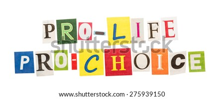 Pro life and pro choice inscriptions made with cut out letters