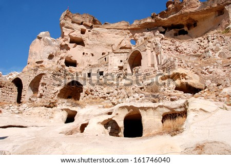 Probably the best known feature of Cappadocia, Turkey found in its very heart, are the fairy chimneys and troglodyte houses of Goreme and its surrounding villages - stock photo