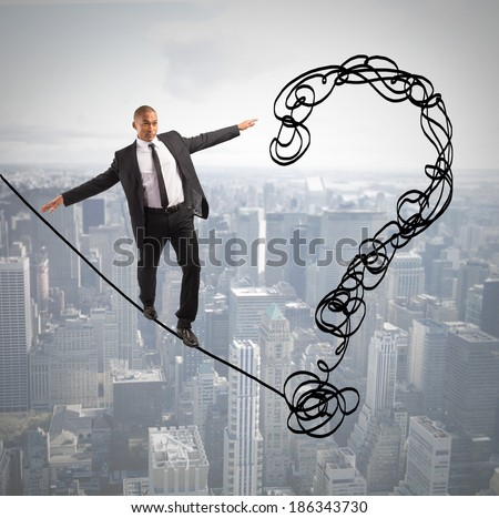 Problem and difficulty concept with businessman on the rope - stock photo