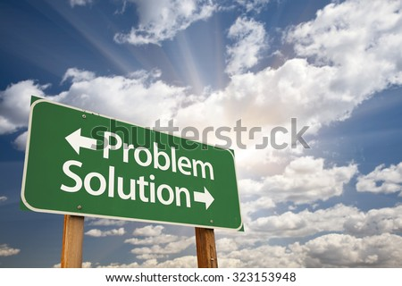 Problem and Solution Green Road Sign With Dramatic Clouds and Sky.