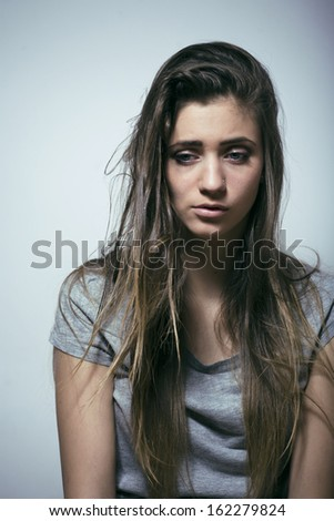 problem depressioned teenage with messed hair and sad face - stock photo