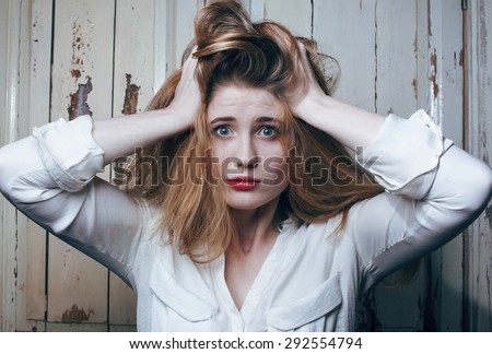 problem depressioned teenage with messed hair and sad face, real junky woman - stock photo