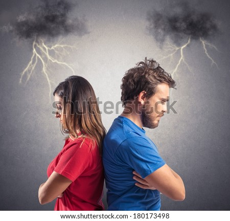 Problem of a young couple with blacks clouds and lightning - stock photo