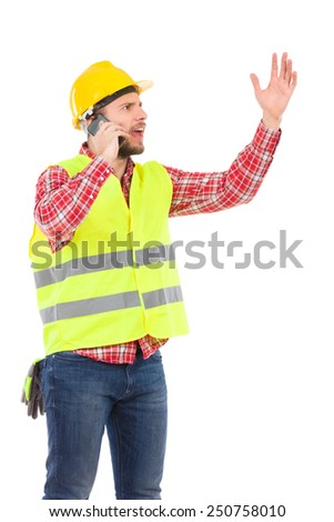 Problem on the phone. Angry manual worker in yellow helmet and lime waistcoat using phone and gesturing. Three quarter length studio shot isolated on white. - stock photo