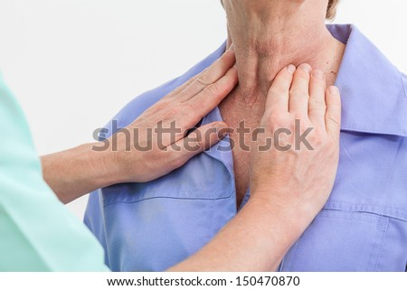 Problems with thyroid, nurse examining a patient - stock photo