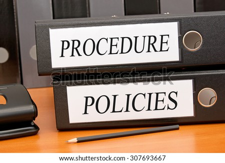 Procedure and Policies - two binders on desk in the office