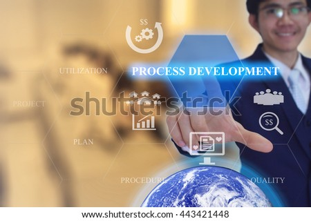PROCESS DEVELOPMENT  concept presented by  businessman touching on  virtual  screen -image element furnished by NASA - GOLDEN TONE - stock photo