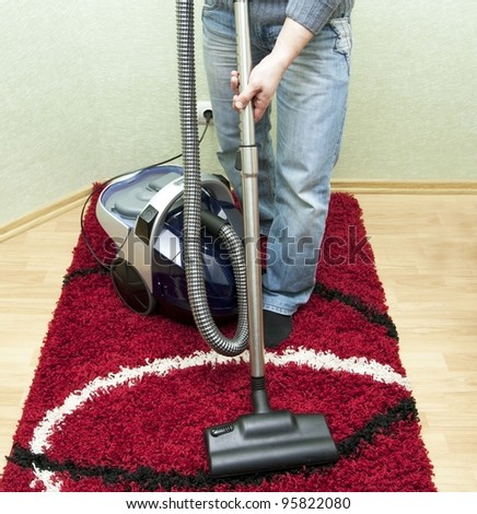 Process of cleaning of a carpet by the vacuum cleaner in a room