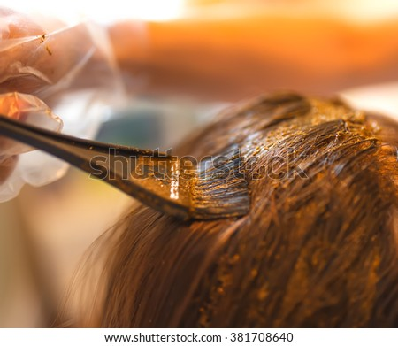 Process of coloring hair with natural henna. - stock photo