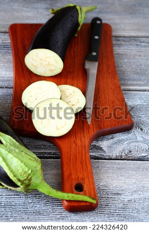 Process of cooking eggplant on a board - stock photo