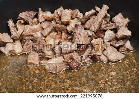 Process of frying of meat - stock photo