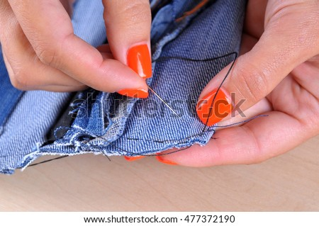 Process of handmade sewing with denim cloth and needle