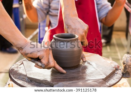 process of make clay vase before go to oven - stock photo